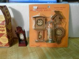 5 DOLLHOUSE CLOCKS IN 2 DIFFERENT PACKAGES.  PACK OF 4 AND A