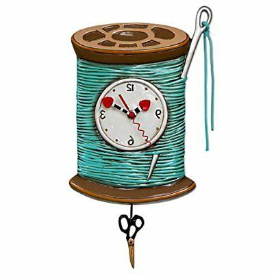 needle and thread whimsical sewing pendulum wall
