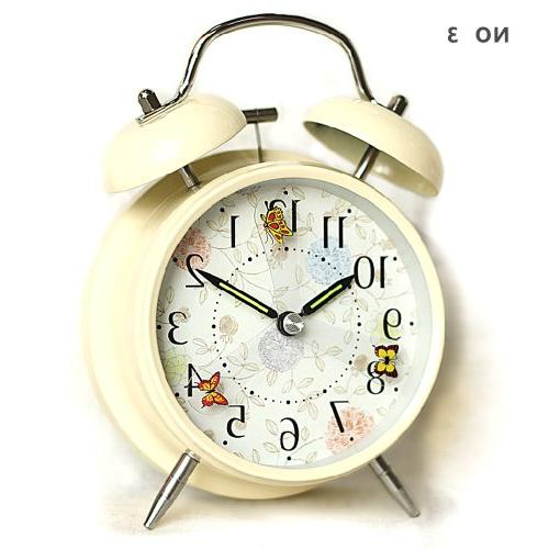 silent alarm clock flying butterfly